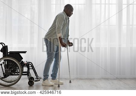 Sports, Physiotherapy And Patient With Leg Injury During Crutches Training