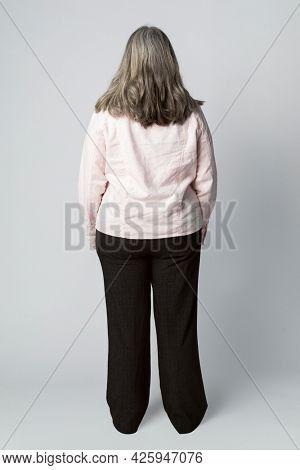 Rear view of a senior woman in studio shoot