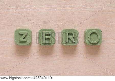 Environmental Background, Block Gypsum Or Concrete Letters Zero On Wooden Background