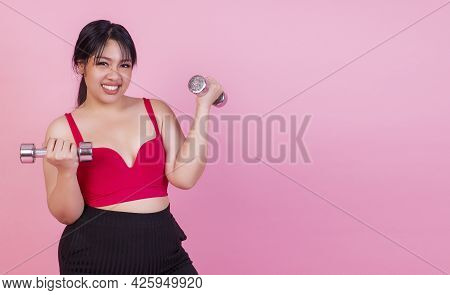 Exercise Bodybuilding Diet Healthy Care Concept. Chubby Obesity Plus- Size Smile Woman Holding Dumbb