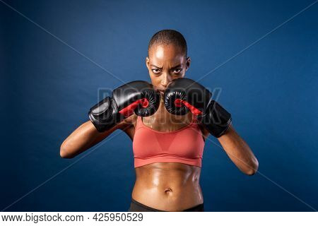 Fit black woman ready for a boxing match