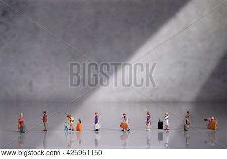 Miniature People In Queue At Airport Terminal