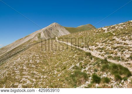 Pathway For The Crest Of Summit Of Redentore Mountain In The National Park Of Monti Sibillini