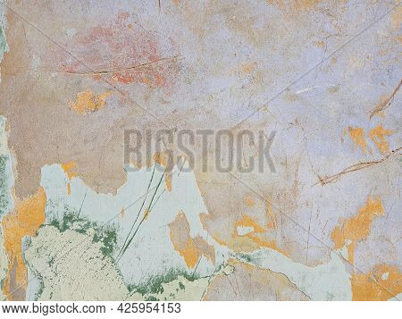 Multi Colored Layers Of Old Plaster. Texture Of Rough Cracked Pink Stucco Texture Background. Decora