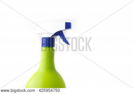 Plastic Spray Yellow Bottle Isolated On White Background. Bottle For Detergent Or For Plant Spraying