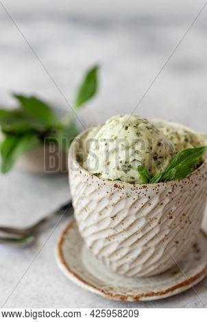 Green Spinach Coconut Ice Cream In A Ceramic Bowl On A Gray Background. Healthy Vegan Dessert. Verti