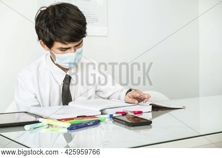Asian Education Man Reading Books So Looking Tablet In Office To Prepare For The Exam Entrance To Le