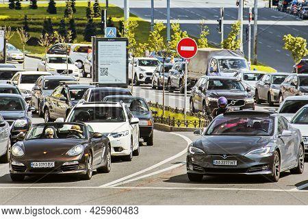Kiev, Ukraine - May 22, 2021: Tesla Model S And Porsche Boxter In The City