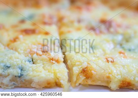 Close-up And Soft Focus Of Baked Pizza With Four Types Of Cheese