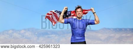USA american athlete waving flag in success winning competition race on blue sky nature landscape background panoramic banner. Man sports win first place.
