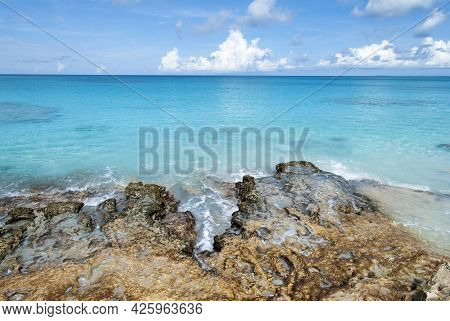 The Scenic View Of Half Moon Cay Rocky Shore And Turquoise Color Waters (bahamas).