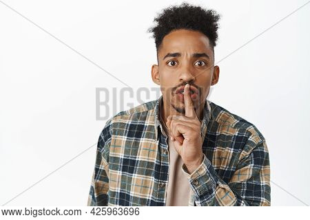 Close Up Of Serious African American Man Hushing, Say Shh And Furrow Eyebrows Angry, Telling To Shut
