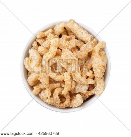 Fried Pork Cracklings On A Bowl Isolated Over White Background.