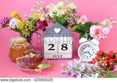Calendar For July 28 : The Name Of The Month Of July In English, Cubes With The Number 28, A Cup Of