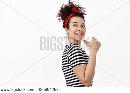 Portrait Of Young Woman, Female Rights Activist, Pointing Finger Left Behind Her Shoulder, Smiling A