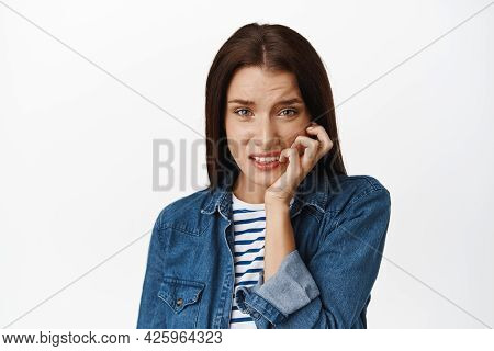 Close Up Of Nervous Woman Biting Fingers And Look Anxious At Camera, Scared Of Smth, Worry And Stare