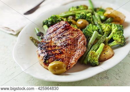 Grilled Turkey Breast With Oven Baked Potatoes And Broccoli. Bright  Wooden Background. Close Up.