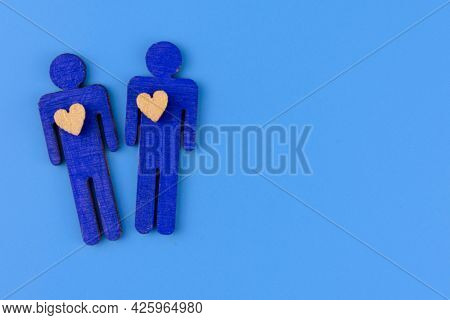 Wo Men In Love On A Blue Background.copy Space. The Concept Of Descremination Of Same-sex Marriage.