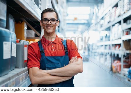 Smiling Supervisor Standing In The Sales Area Of A Hardware Store.
