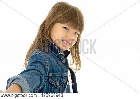 Portrait Of Happy Girl In Stylish Outfit. Beautiful Smiling Brown Eyed Preteen Girl Wearing Denim Ja