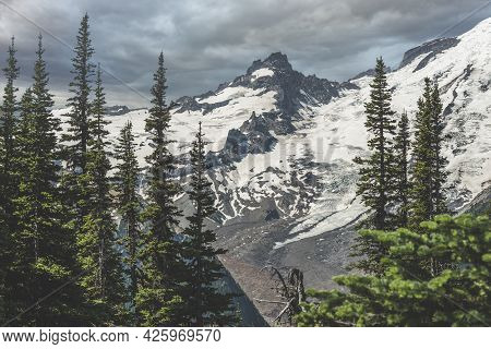 Peaks And Glaciers.\nmt Rainier National Forest, Breath Taking View Of A Mountain Peak Called \