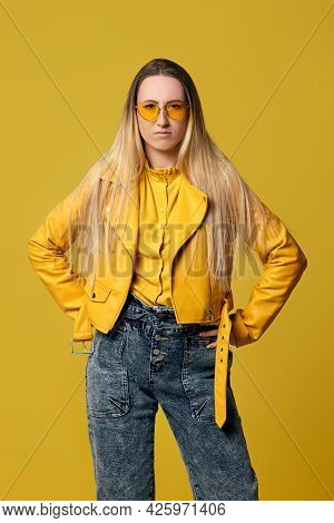 Fashionable Blonde Woman In Sunglasses And Leather Jacket