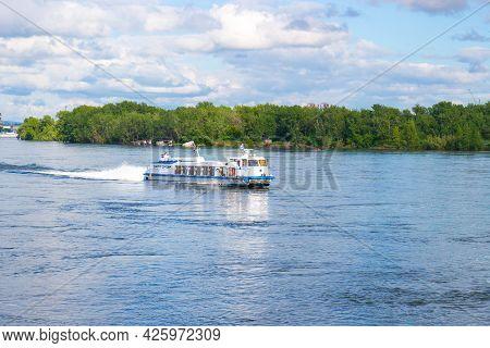 Krasnoyarsk, Russia - June 21, 2021: River Tram Ship Moves Along The Yenisey River In Sunny Day