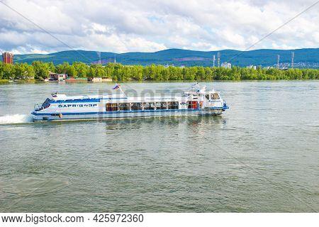 Krasnoyarsk, Russia - June 21, 2021: Water Bus Moves Along The Yenisey River In Sunny Summer Day