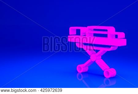 Pink Stretcher Icon Isolated On Blue Background. Patient Hospital Medical Stretcher. Minimalism Conc