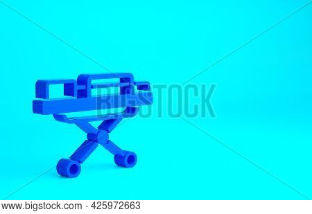 Blue Stretcher Icon Isolated On Blue Background. Patient Hospital Medical Stretcher. Minimalism Conc