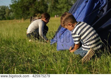 Brother And Sister Learn To Pitch A Tent