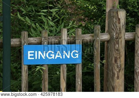 Sign On A Wooden Fence In German - Entrance
