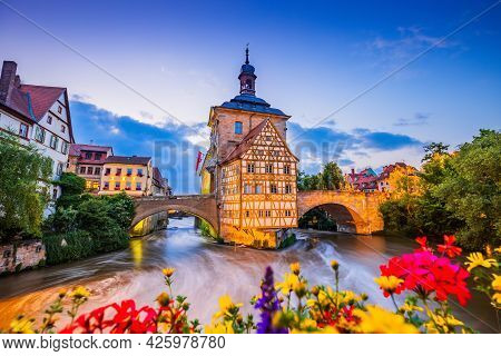 Bamberg, Germany. Town Hall Of Bamberg (altes Rathaus) With Two Bridges Over The Regnitz River. Uppe