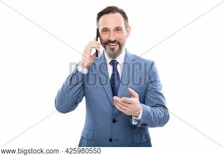 Smiling Grizzled Entrepreneur In Suit Talking On Smartphone Isolated On White, Business Negotiations