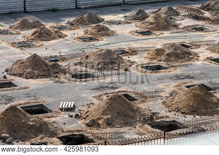 Rows Of Pits At A Construction Site. Preparation Of The Site For The Installation Of Piles. A Pile O