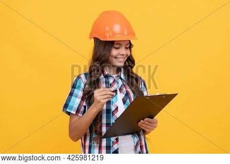 Future Engineer Hold Clipboard. Safety Work Expertise. Teen Girl In Protective Hard Hat