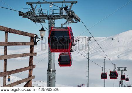 Gondola Type Ropeway On The Slope Of Ski Resort Above Clouds. Erciyes Ski Resort. Kayseri, Turkey