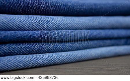A Stack Of Denim. Color Denim Close-up Texture.
