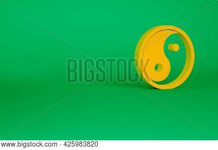 Orange Yin Yang Symbol Of Harmony And Balance Icon Isolated On Green Background. Minimalism Concept.