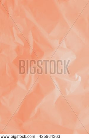 Paper Crumpled Background Of Tangerine, Peach Color. Vertical Background. High Quality Photo