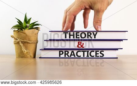 Theory And Practices Symbol. Books With Words 'theory And Practices'. Beautiful Wooden Table, White