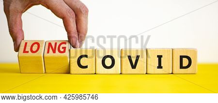 Long Covid Symbol. Doctor Turnes Wooden Cubes And Changes Words 'covid' To 'long Covid'. Beautiful Y