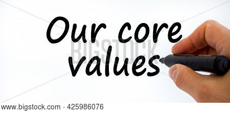 Our Core Values Symbol. Businessman Writing 'our Core Values', Isolated On White Background. Busines