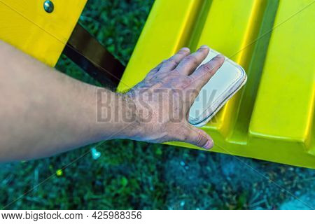 The Men's Hand Reaches For The Woman's Purse, Which Lies On The Bench For The Purpose Of Theft. Park
