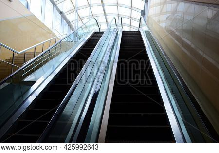 Escalator In Perspective In A Building, Descent And Ascent On An Escalator.