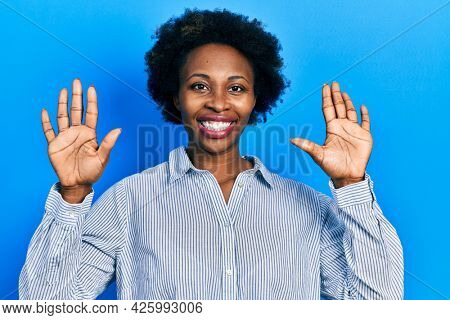 Young african american woman wearing casual clothes showing and pointing up with fingers number ten while smiling confident and happy.