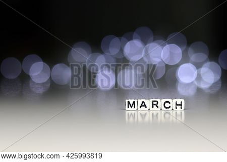 March Is A Word Written On A White Block. March Is The Word For Your Design, Concept. Beautiful Boke