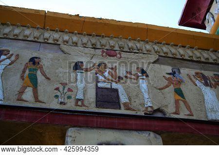 Egyptian Sculpture, A Fragment Of An Egyptian Fresco On A Stone Wall.