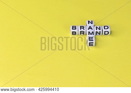 Name Brand Word Written On Wood Block. Name Brand Text On Wooden Table For Your Desing, Concept.