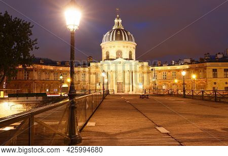The View Of French Academy And Arts Bridge At Night , Paris, France.